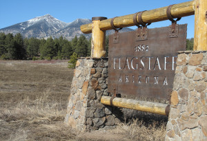 Flagstaff sign with San Fransisco Peaks in the background